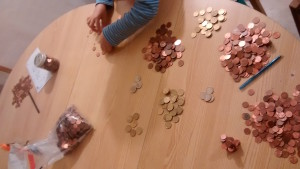 Counting money donated to refugees in the Languedoc.