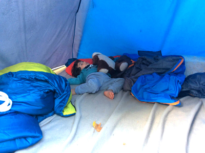Refugee baby in tent